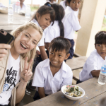 KATE HUDSON WITH CAMBODIAN CHILDREN CANDID