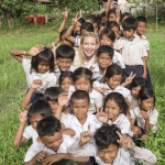KATE HUDSON WITH GROUP OF CAMBODIAN CHILDREN