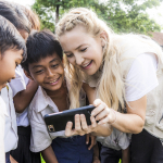 KATE SHOWING CAMBODIAN CHILDREN PICTURES