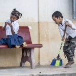 BOY CLEANING UP AT SCHOOL WITH GIRL