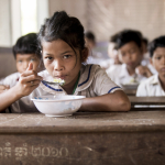 CAMBODIAN STUDENT EATING AT SCHOOL